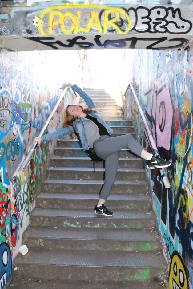 Model, Posing on the stairwell of an exit/entrance to Leake St, Waterloo, London. City Street Art UK